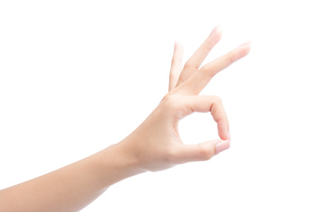 Foto de Woman Hand OK sign, Isolated on white with clipping path included - Imagen libre de derechos