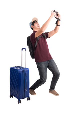 Photo pour Traveler man. Young asian man with suitcase and camera isolated on white with Clipping path. - image libre de droit