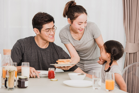 Photo for Happy family having breakfast at home - Royalty Free Image