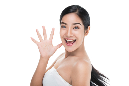 Foto de Beautiful woman cares for the skin face showing hello sign,Asian Beauty. - Imagen libre de derechos
