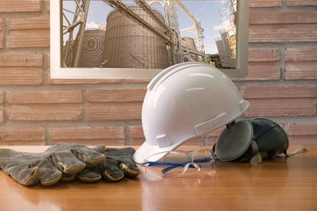 Foto de Safety standard set on working table,Safety in factory Concept,  Background of old vintage brick wall - Imagen libre de derechos