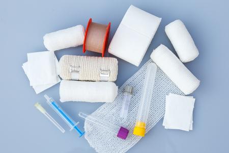 Foto de Medical bandages with sticking plaster and syringes for medical,healthcare or pharmacy themes - Imagen libre de derechos
