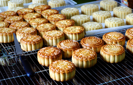 Photo for Doing moon cake for mid autumn festival at home, group of sweet cakes on tray, baking at home attractive many housewife that make food safety with delicious homemade product - Royalty Free Image