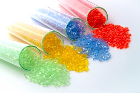 Foto de transparent plastic granulate in Test tubes - Imagen libre de derechos