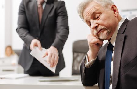 Foto de Indifferent employer expressing apathy in the office - Imagen libre de derechos