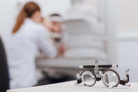 Foto de Selective focus of eye test spectacles lying on the table - Imagen libre de derechos