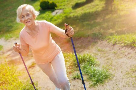 Foto de Happy delighted woman using walking poles - Imagen libre de derechos