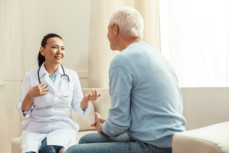 Photo for Delighted positive nurse talking to her patient - Royalty Free Image