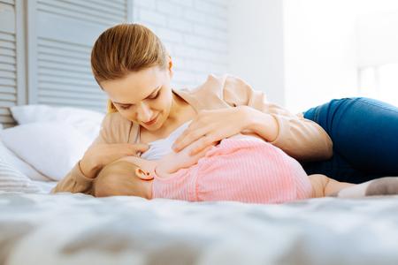 Foto de Calm morning of a loving breastfeeding mother - Imagen libre de derechos