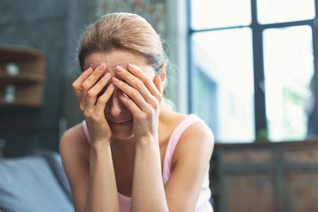 Foto de Emotional burden. Mournful mature woman covering face and weeping - Imagen libre de derechos