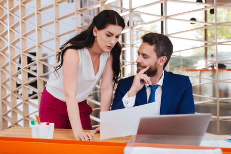Photo for Sexual harassment. Excited bearded man looking lustfully while working with his secretary - Royalty Free Image