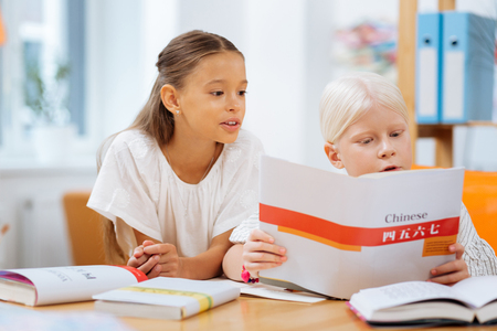 Photo for New language. Smart children being concentrated while learning Chinese together - Royalty Free Image