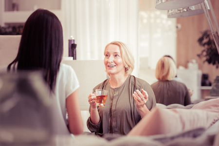 Photo for Happy femininity. Pretty mature female actively gesticulating while talking to her friend - Royalty Free Image