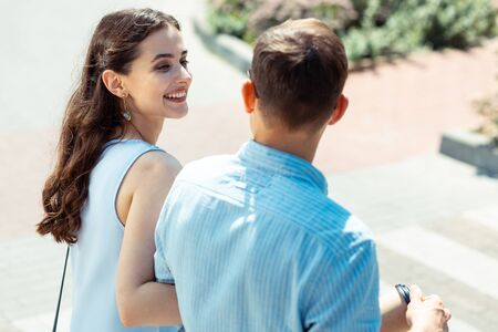 Photo for Time with husband. Curly appealing young wife feeling amazing while spending time with husband - Royalty Free Image