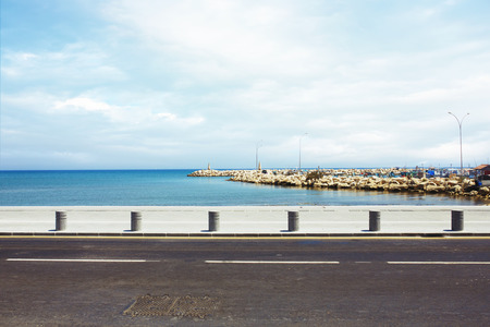 Photo for Asphalt road near the port and sea promenade - Royalty Free Image
