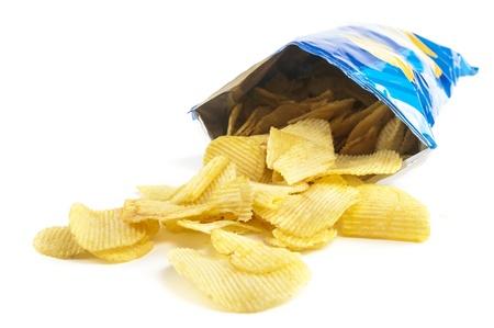Photo for heap of potato crisps on white background - Royalty Free Image
