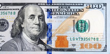 Foto de Macro shot of a new 100 dollar bill. - Imagen libre de derechos