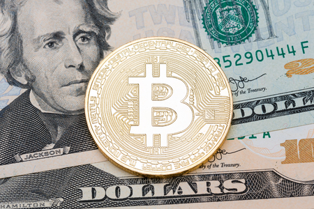 Photo pour Golden bitcoin coin on us dollars close up. - image libre de droit