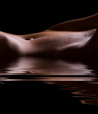 Female Tummy in the  on black background in water