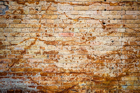 Foto de Background wall from an ancient yellow vintage brick with rusty corrosion patterns on the surface. Textured background in grunge style. Procurement for stylish graffiti - Imagen libre de derechos