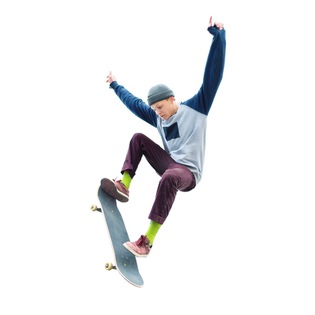 Photo for A teenage boy in a hat and a sweatshirt jumping with a skateboard does a trick on an isolated white background. The cut out character the preparation - Royalty Free Image