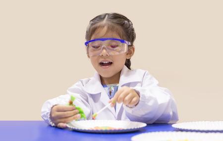 Foto de select focus asian kid in scientist uniform and learn chemical lab - Imagen libre de derechos