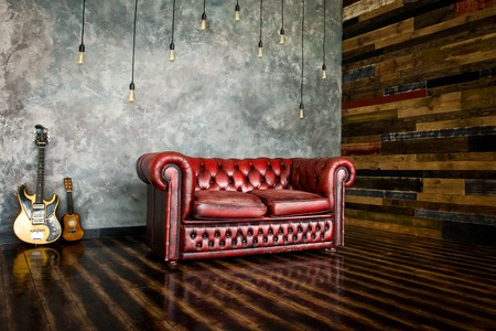 Photo for The divan is an honor of burgundy color in the interior - Royalty Free Image