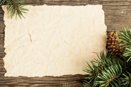 Photo for Blank vintage paper framed branch of Christmas tree on wood - Royalty Free Image