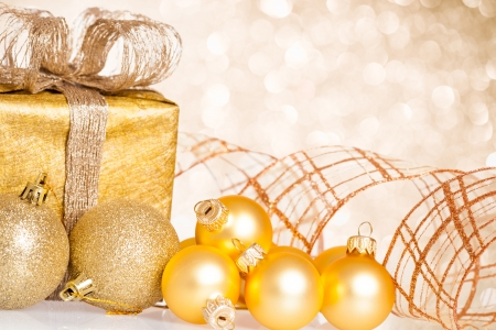 Photo for Golden Christmas tree decorations against lights background - Royalty Free Image