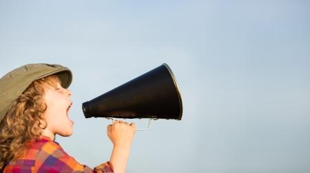 Photo for Kid shouting through vintage megaphone - Royalty Free Image