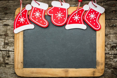 Photo for Christmas tree decorations border on vintage wooden blackboard  Winter holidays concept  Copy space for your text - Royalty Free Image