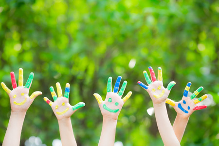 Photo for Group of smiley hands against green spring  - Royalty Free Image