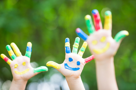 Foto de Happy smiley hands against green spring background - Imagen libre de derechos