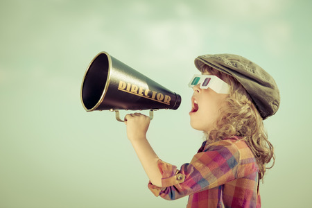Foto per Kid shouting through vintage megaphone - Immagine Royalty Free