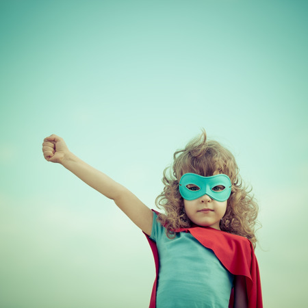 Photo for Superhero kid against summer sky background. Girl power and feminism concept - Royalty Free Image
