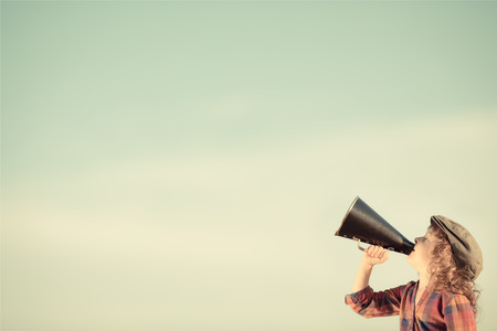 Photo pour Kid shouting through vintage megaphone. Communication concept. Retro style - image libre de droit