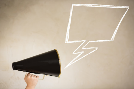 Photo for Vintage megaphone and drawing speech bubble - Royalty Free Image