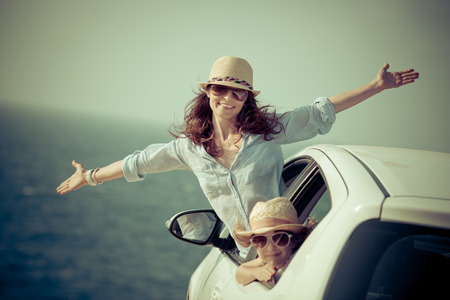 Foto de Happy family at the beach. Summer car trip. Vacations concept - Imagen libre de derechos