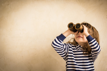 Photo for Smiling child with spyglass. - Royalty Free Image