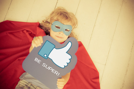 Photo for Superhero child holding LIKE sign. Social media concept. Retro toned - Royalty Free Image