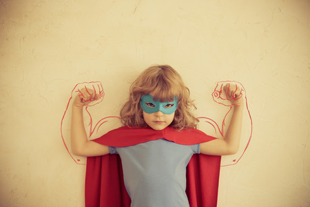 Photo pour Strong superhero child with drawn muscles. Girl power and feminism concept - image libre de droit