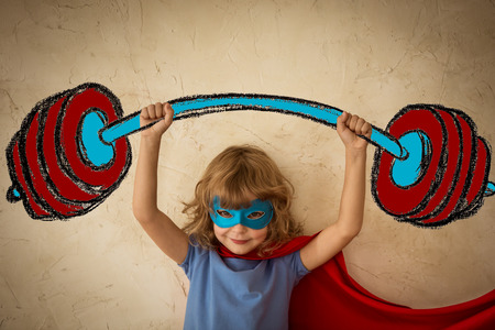 Photo for Superhero child against grunge wall background. Success and winner concept - Royalty Free Image
