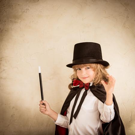 Foto de Child magician holding a wand - Imagen libre de derechos
