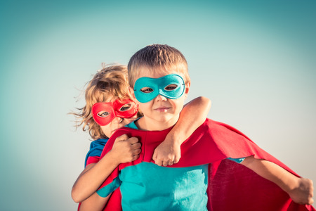 Photo for Superhero children against summer sky background. Kids having fun outdoors. Boy and girl playing. Success and winner concept - Royalty Free Image