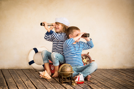 Photo for Children playing with vintage nautical things. Kids having fun at home. Travel and adventure concept. Retro toned image - Royalty Free Image