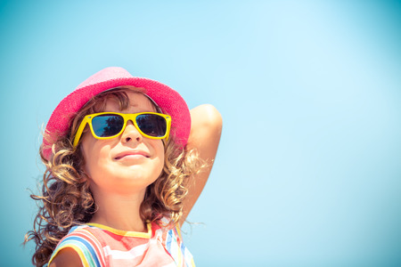 Foto de Happy child on summer vacation. Travel and adventure concept - Imagen libre de derechos