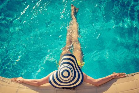 Foto de Young woman in swimming pool. Summer vacation concept - Imagen libre de derechos