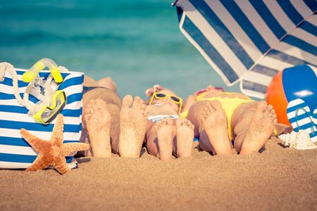 Photo pour Happy family lying on the beach. Summer vacation concept - image libre de droit