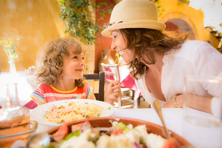 Photo for Mother and child having fun in summer cafe outdoors - Royalty Free Image