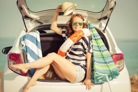 Foto de Woman on vacation. Summer holiday and car travel concept - Imagen libre de derechos